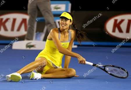 Ana Ivanovic of Serbia Falls to the Floor During Her 1st Round Match Against Melinda Czink of Hungary at the Australian Open Grand Slam Tennis Tournament in Melbourne Australia 14 January 2013 Australia Melbourne