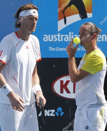 Belgian Double Xavier Malisse (r) and Dick Norman During Their 1st Round Doubles Match Against Nicholas Monroe of the Us and Grega Zemlja of Slovenia at the Australian Open Grand Slam Tennis Tournament in Melbourne Australia 17 January 2013 Australia Melbourne