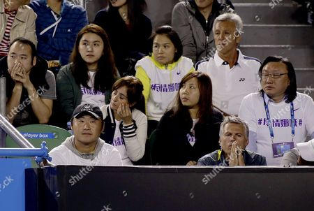 Jiang Shan (front L) Husband of Chinese Tennis Player Li Na Watches Her Playing in the Women's Final Match Against Victoria Azarenka of Belarus at the Australian Open Grand Slam Tennis Tournament in Melbourne Australia 26 January 2013 Australia Melbourne