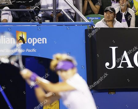Jiang Shan Husband of Chinese Tennis Player Li Na (foreground) Watches Her Playing in the Women's Final Match Against Victoria Azarenka of Belarus at the Australian Open Grand Slam Tennis Tournament in Melbourne Australia 26 January 2013 Australia Melbourne