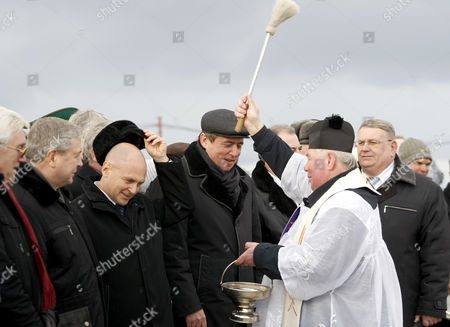 Chief Executive Official of the Rosatom State Atomic Energy Corporation Sergei Kiriyenko (3-l) and Belarusian Vice Prime-minister Vladimir Semashko (2-l) Are Blessed by a Catholic Priest at the Construction Site of the Belarusian Nuclear Power Plant Near the Town of Ostrovets Some 180 Km From Minsk Belarus 01 February 2013 Belarus Ostrovets