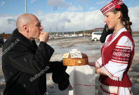 Chief Executive Official of the Rosatom State Atomic Energy Corporation Sergei Kiriyenko Tastes a Piece of Belarusian Bread and Salt on the Construction Site of the Belarusian Nuclear Power Plant Near the Town of Ostrovets Some 180 Km From Minsk Belarus 01 February 2013 Belarus Ostrovets