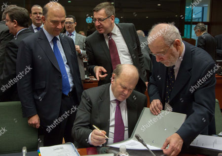 Stock Picture of French Finance Minister Pierre Moscovic (l) Belgian Finance Minister Steven Vanackere (r) and Irish Finance Minister Michael Noonan (c) at the Start of an Ecofin Finance Ministers' Meeting at the Eu Headquarters in Brussels Belgium 12 February 2013 Dutch Finance Minister and President of the Eurogroup Jeroen Dijsselbloem (not Pictured) Reportedly Stated That the Eurozone Finance Ministers Will not Make a Decision on a Bailout For Cyprus Until March - After the Island Holds Presidential Elections This Month Belgium Brussels