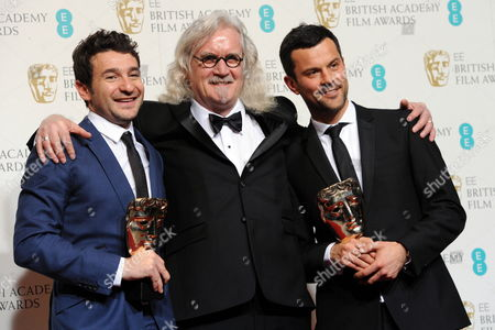 Director Bart Layton (l) and Producer Dimitri Doganis Winners of the Outstanding Debut by a British Writer Director Or Producer Award For 'The Imposter' Pose with Scottish Comedian/presenter Billy Connolly (c) in the Press Room During the Ee British Academy Film Awards in London Britain 10 February 2013 the Ceremony was Hosted by the British Academy of Film and Television Arts (bafta) United Kingdom London