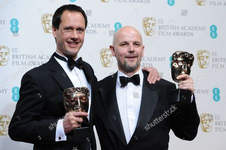 Producers Diarmid Scrimshaw (l) and Peter Carlton Pose in the Press Room After Winning the Short Film Award For 'Swimmer' During the Ee British Academy Film Awards in London Britain 10 February 2013 the Ceremony was Hosted by the British Academy of Film and Television Arts (bafta) United Kingdom London