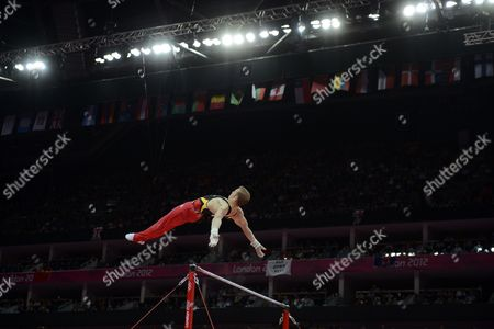 Fabian Hambuchen of Germany Competes En Route to the Silver Medal in the Men's Horizontal Bar at the London 2012 Olympic Games Artistic Gymnastics Competition London Britain 07 August 2012 United Kingdom London