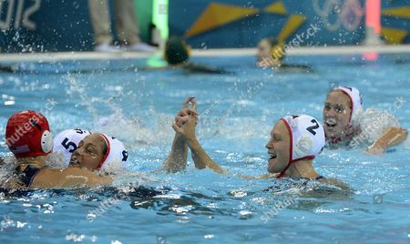 Heather Petri (2-r) of the Usa Celebrates with Lauren Wenger (l) and Brenda Villa (3-l) After Their 11-9 Win Over Australia During a Women's Olympic Water Polo Semi-final Match at the Water Polo Arena Inside the Olympic Park in London During the London 2012 Olympic Games London Britain 07 August 2012 United Kingdom London