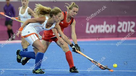 Merel De Blaeij of the Netherlands Vies For the Ball with Great Britain's Laura Bartlett (r) During a Women's Field Hockey Preliminary Round Match at the Riverbank Arena at the London 2012 Olympic Games Field Hockey Competition London Britain 06 August 2012 United Kingdom London