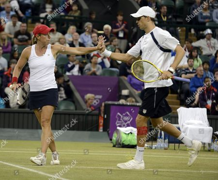 Mike Bryan and Lisa Raymond of Usa in Action Against Sabine Lisicki and Christopher Kas of Germany of Usa in the Mixed Doubles Final During the London 2012 Olympic Games Tennis Competition in Wimbledon Greater London Britain 05 Augusr 2012 United Kingdom Wimbledon