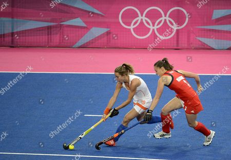 Ellen Hoog of the Netherlands (l) Gets Away From Great Britain's Emily Maguire During a Women's Field Hockey Preliminary Round Match at the Riverbank Arena at the London 2012 Olympic Games Field Hockey Competition London Britain 06 August 2012 United Kingdom London