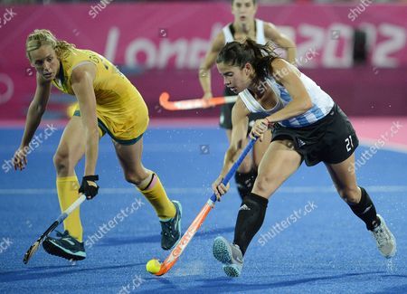 Argentina's Mariela Scarone (r) Defends Aginast Australia's Fiona Boyce (l) During a Women's Field Hockey Preliminary Round Match at the Riverbank Arena in London During the London 2012 Olympic Games London Britain 06 August 2012 United Kingdom London