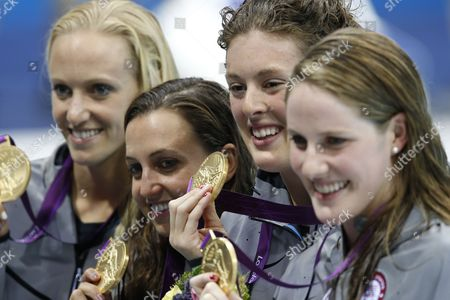 (l-r) Dana Vollmer Rebecca Soni Allison Schmitt and Missy Franklin of the Us Celebrate a New World Record in the Women's 4x100m Medley Relay Final During the Swimming Competition Held at the Aquatics Center During the London 2012 Olympic Games in London England 4 August 2012 United Kingdom London