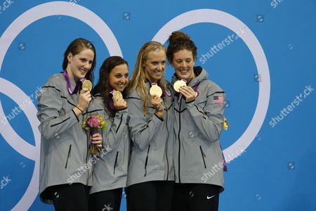 (l-r) Missy Franklin Rebecca Soni Dana Vollmer and Allison Schmitt of the Us Celebrate a New World Record in the Women's 4x100m Medley Relay Final During the Swimming Competition Held at the Aquatics Center During the London 2012 Olympic Games in London England 4 August 2012 United Kingdom London