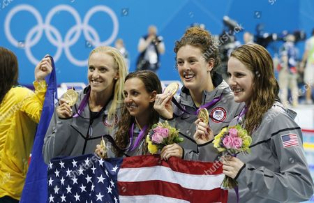 (l-r) Us Swimmers Dana Vollmer Rebecca Soni Allison Schmitt and Missy Franklin Celebrate After Winning the Gold Medal in the Women's 4x100m Medley Relay During the London 2012 Olympic Games Swimming Competition London Britain 04 August 2012 United Kingdom London