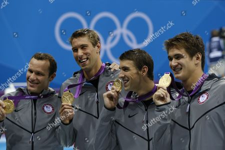 Usa (l-r: Brendan Hansen Matthew Grevers Michael Phelps Nathan Adrian) Team with the Gold Medal During the Medal Ceremony of the Men's 4 X 100m Medley Relay at the London 2012 Olympic Games Swimming Competition London Britain 04 August 2012 Epa/barbara Walton United Kingdom London