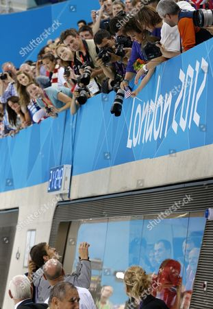 Michael Phelps of the Us Reaches For a Us Flag From His Mother Debbie Phelps After He Won Gold in the Men's 4x100m Medley Relay in the London 2012 Olympic Games Swimming Competition in London Britain 04 August 2012 United Kingdom London