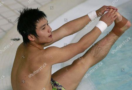 Qiu Bo of China Stretches After Competing in the Men's 10m Platform Semi-final Diving Competition and Coming First in the Standings For the Finals at the Aquatics Center During the London 2012 Olympic Games London Britain 11 August 2012 United Kingdom London