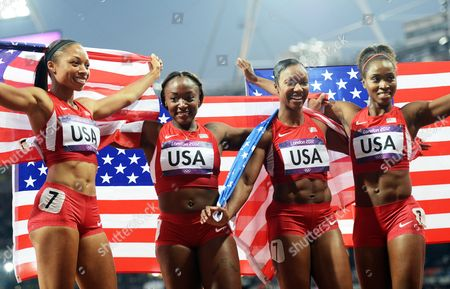 (from Left) Allyson Felix Bianca Knight Carmelita Jeter and Tianna Madison of the Us Celebrate After Winning the Women's 4x100m Relay at the Olympic Stadium London Britain 10 August 2012 United Kingdom London