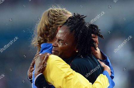 Swedish Emma Green Tregaro (l) Hugs Chaunte Lowe of the Usa After Both Dropped out in the Women's High Jump Final at the London 2012 Olympic Games Athletics Track and Field Events at the Olympic Stadium London Britain 11 August 2012 United Kingdom London