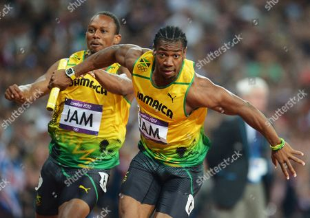 Michael Frater (l) Hands the Baton to Jamaican Teammate Yohan Blake During the Men's 4x100m Final at the London 2012 Olympic Games Athletics Track and Field Events at the Olympic Stadium London Britain 11 August 2012 United Kingdom London