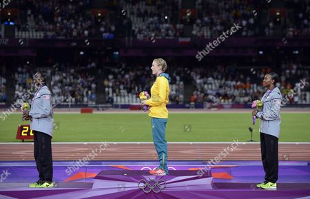 Gold Medalist Sally Pearson (c) of Australia (c) is Flanked by Silver Medalist Dawn Harper of the Us and Bronze Winner Kellie Wells of the Us During the Medal Ceremony For the 100m Hurdles at the London 2012 Olympic Games Athletics Track and Field Events at the Olympic Stadium London Britain 08 August 2012 United Kingdom London