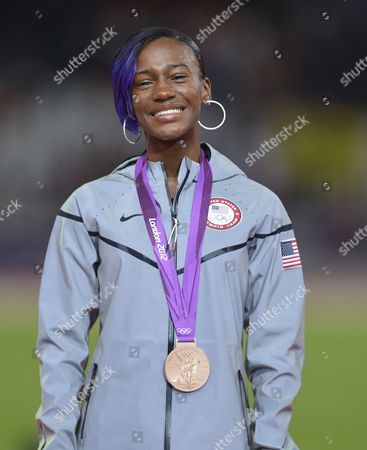 Bronze Winner Kellie Wells of the Us During the Medal Ceremony For the 100m Hurdles at the London 2012 Olympic Games Athletics Track and Field Events at the Olympic Stadium London Britain 08 August 2012 United Kingdom London