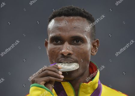 Ethiopia's Dejen Gebremeskel Celebrates Winning Silver During the Medal Ceremomy For the Men's 5000m Final at the London 2012 Olympic Games Athletics Track and Field Events at the Olympic Stadium London Britain 11 August 2012 United Kingdom London