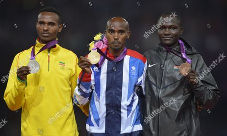 Britain's Mohamed Farah (c) with Gold Ethiopia's Dejen Gebremeskel (l) with Silver and Kenia's Thomas Pkemei Longosiwa with Bronze Pose During the Medal Ceremomy For the Men's 5000m Final at the London 2012 Olympic Games Athletics Track and Field Events at the Olympic Stadium London Britain 11 August 2012 United Kingdom London