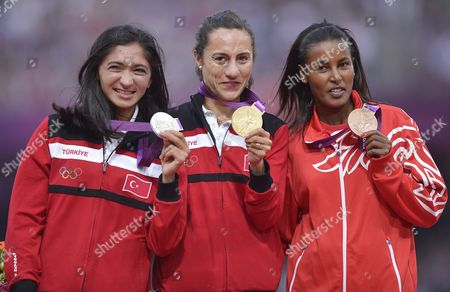 Stock Image of Gold Medalist Asli Cakir Alptekin of Turkey (c) is Flanked by Silver Medalist Gamze Bulut of Turkey (l) and Bronze Medal Winner Maryam Yusuf Jamal of Bahrain During the Medal Ceremony For the Women's 1500m at the London 2012 Olympic Games Athletics Track and Field Events at the Olympic Stadium London Britain 11 August 2012 United Kingdom London