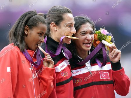 Stock Picture of Gold Medalist Asli Cakir Alptekin of Turkey (c) is Flanked by Silver Medalist Gamze Bulut of Turkey (r) and Bronze Medal Winner Maryam Yusuf Jamal of Bahrain During the Medal Ceremony For the Women's 1500m at the London 2012 Olympic Games Athletics Track and Field Events at the Olympic Stadium London Britain 11 August 2012 United Kingdom London