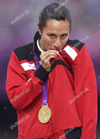 Gold Medalist Asli Cakir Alptekin of Turkey During the Medal Ceremony For the Women's 1500m at the London 2012 Olympic Games Athletics Track and Field Events at the Olympic Stadium London Britain 11 August 2012 United Kingdom London