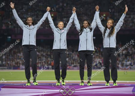 Usa's Sanya Richards-ross Francena Mccorory Allyson Felix and Deedee Trotter Celebrate Winning Gold in the Women's 4 X 400m Relay Final During the London 2012 Olympic Games Athletics Track and Field Events at the Olympic Stadium London Britain 11 August 2012 United Kingdom London
