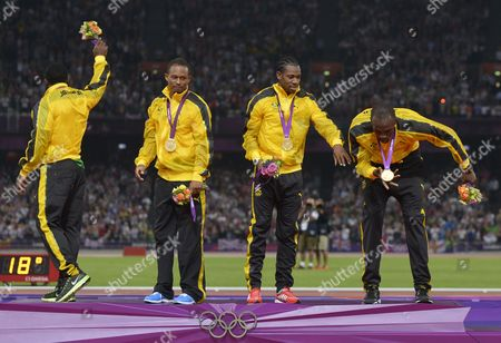Jamaica's Usain Bolt Yohan Blake Michael Frater and Nesta Carter Celebrate Winning the Gold Medal in the Men's 4 X 100m Relay Final During the London 2012 Olympic Games Athletics Track and Field Events at the Olympic Stadium London Britain 11 August 2012 United Kingdom London