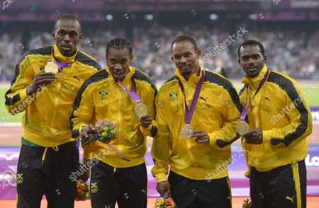 (l-r) Jamaica's Usain Bolt Yohan Blake Michael Frater and Nesta Carter Celebrate Winning the Gold Medal in the Men's 4 X 100m Relay Final During the London 2012 Olympic Games Athletics Track and Field Events at the Olympic Stadium London Britain 11 August 2012 United Kingdom London