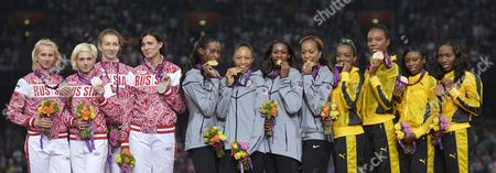 Silver Medalists Yulia Gushchina Antonina Krivoshapka Tatyana Firova and Natalya Antyuk of Russia (l) Gold Medalist Deedee Trotter Allyson Felix Francena Mccorory and Sanya Richards-ross of the Us and Bronze Medalists Christine Day Rosemarie Whyte Shericka Williams and Novlene Williams-mills of Jamaica Pose with Their Medals After the Women's 4 X 400m Relay Final During the London 2012 Olympic Games Athletics Track and Field Events at the Olympic Stadium London Britain 11 August 2012 United Kingdom London