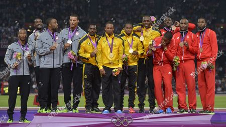 Gold Medalists Yohan Blake Usain Bolt Nesta Carter and Michael Frater of Jamaica (c) Silver Medalists Trell Kimmons Justin Gatlin Tyson Gay and Ryan Bailey of the Us (l) and Bronze Medalists Keston Bledman Marc Burns Emmanuel Callender and Richard Thompson of Trinidad and Tobago Celebrate After in the Men's 4 X 100m Relay Final During the London 2012 Olympic Games Athletics Track and Field Events at the Olympic Stadium London Britain 11 August 2012 United Kingdom London