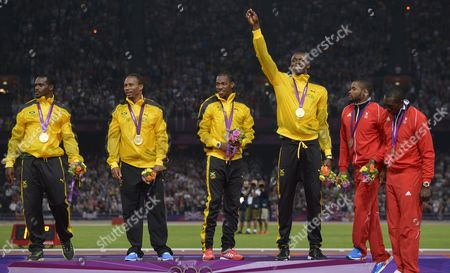 Jamaica's Gold Medalists Usain Bolt (3rd R-l) Yohan Blake Michael Frater and Nesta Carter Celebrate on the Podium Next to Emmanuel Callender (2ndr) and Marc Burns of Trinidad and Tobaco After the Men's 4 X 100m Relay Final During the London 2012 Olympic Games Athletics Track and Field Events at the Olympic Stadium London Britain 11 August 2012 United Kingdom London
