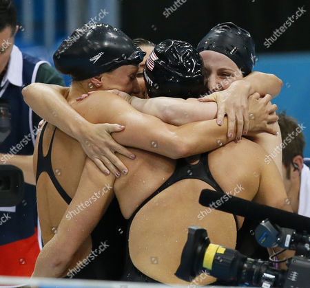 (l-r) Us Swimmers Dana Vollmer Rebecca Soni and Missy Franklin with Allison Schmitt (back to Camera) After Winning the Gold Medal in the Women's 4x100m Medley Relay During the London 2012 Olympic Games Swimming Competition London Britain 04 August 2012 United Kingdom London