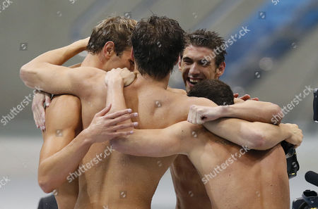 Us Team Members (l-r) Matthew Grevers Nathan Adrian Michael Phelps and Brendan Hansen Celebrate After Winning the Gold Medal in the Men's 4x100m Medley Relay During the Swimming Competition Held at the Aquatics Center in the London 2012 Olympic Games in London England 04 August 2012 United Kingdom London