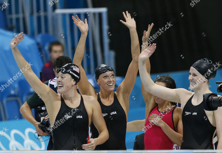 (l-r) Us Swimmers Allison Schmitt Dana Vollmer Rebecca Soni and Missy Franklin Celebrate Winning the Gold Medal in the Women's 4x100m Medley Relay During the London 2012 Olympic Games Swimming Competition London Britain 04 August 2012 United Kingdom London