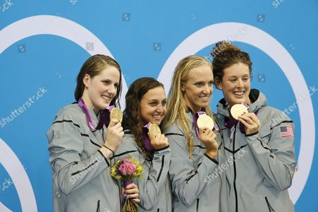 (l-r) Missy Franklin Rebecca Soni Dana Vollmer and Allison Schmitt of the Us Celebrate a New World Record in the Women's 4x100m Medley Relay Final During the Swimming Competition Held at the Aquatics Center During the London 2012 Olympic Games in London England 4 August 2012 the London 2012 Olympic Games Swimming Competition London Britain United Kingdom London