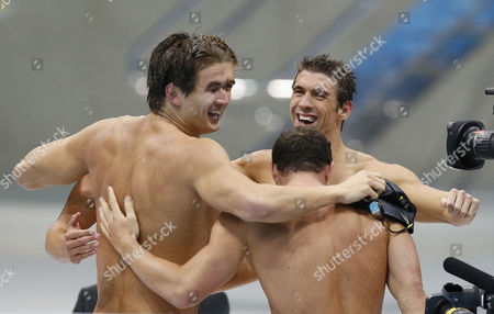 Us Team Members (l-r) Nathan Adrian Matthew Grevers (obscured) Brendan Hansen (back to Camera) and Michael Phelps Celebrate After Winning the Gold Medal in the Men's 4x100m Medley Relay During the Swimming Competition Held at the Aquatics Center in the London 2012 Olympic Games in London England 04 August 2012 United Kingdom London