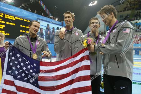 Us Swimmers (l-r) Brendan Hansen Matthew Grevers Michael Phelps and Nathan Adrian After Winning the Gold Medal in the Men's 4x100m Medley Relay During the Swimming Competition Held at the Aquatics Center in the London 2012 Olympic Games in London England 04 August 2012 United Kingdom London