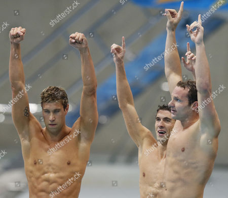 Us Team Members (l-r) Matthew Grevers Michael Phelps and Brendan Hansen Celebrate After Winning the Gold Medal in the Men's 4x100m Medley Relay During the Swimming Competition Held at the Aquatics Center in the London 2012 Olympic Games in London England 04 August 2012 United Kingdom London