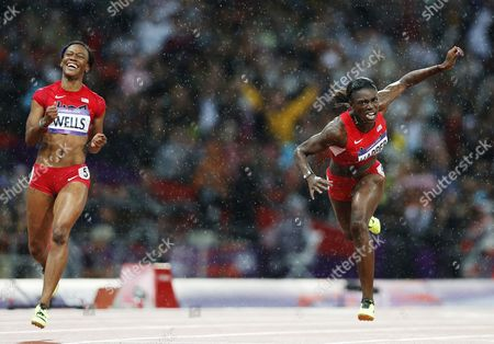 Dawn Harper (r) and Kellie Wells of the Us Cross the Finish Line Placing Second and Third Respectively in the 100m Hurdles Final at the London 2012 Olympic Games Athletics Track and Field Events at the Olympic Stadium London Britain 07 August 2012 United Kingdom London