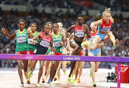 Yuliya Zaripova of Russia (r) Leads the Pack of Runners Over the Hurdle on Her Way Winning the Women's 3000m Steeplechase Final at the London 2012 Olympic Games Athletics Track and Field Events at the Olympic Stadium London Britain 06 August 2012 United Kingdom London