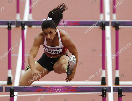 Nevin Yanit of Turkey Clears a Hurdle in the Heats For the Women's 100m Hurdles at the London 2012 Olympic Games Athletics Track and Field Events at the Olympic Stadium London Britain 06 August 2012 United Kingdom London