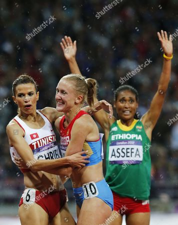 Yuliya Zaripova of Russia (c) Celebrates Winning the Women's 3000m Steeplechase Final with Second Placed Habiba Ghribi of Tunisia (l) and Third Placed Sofia Assefa of Ethiopia at the London 2012 Olympic Games Athletics Track and Field Events at the Olympic Stadium London Britain 06 August 2012 United Kingdom London