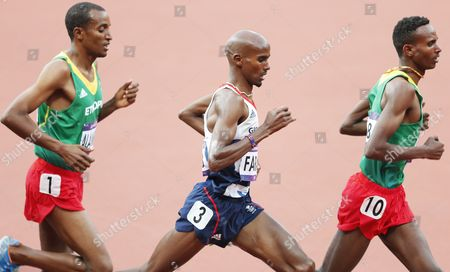 Britain's Mohamed Farah (c) Runs Between Yenew Alamirew (l) and Dejen Gebremeskel (r) of Ethiopia During the Men's 5000m Final at the London 2012 Olympic Games Athletics Track and Field Events at the Olympic Stadium London Britain 11 August 2012 United Kingdom London