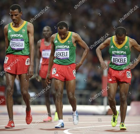 Stock Picture of Ethopian Runners Tariku Bekele (c) Kenenisa Bekele (r) and Gebregziabher Gebremariam (l) Walk Off After the Men's 10000m Final During the London 2012 Olympic Games Athletics Track and Field Events at the Olympic Stadium London Britain 04 August 2012 United Kingdom London